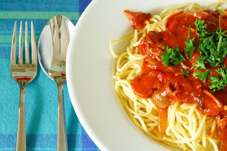 Plate of spaghetti with tomato sauce on a white plate. photo