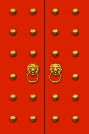 Red chinese door with a liondragon head. Concept: Chinese New Year celebration. photo