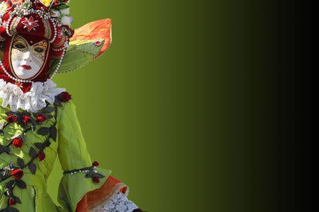 Model dressed in a costume with a decorated venetian mask. Copy space. photo