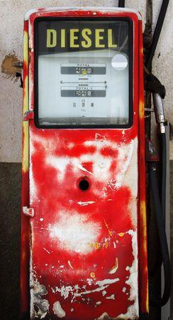 benzine: Antique diesel gas pump in red color.