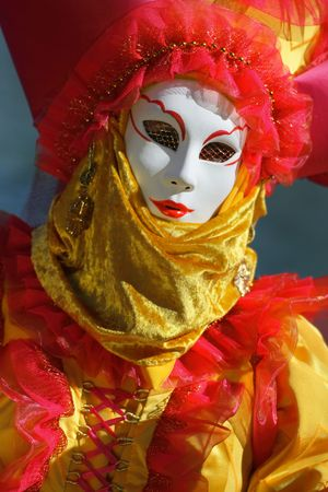 Model dressed in a costume with a decorated venetian mask in bright colors. photo