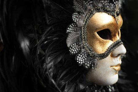 Venetian mask decorated with gold leaf and embedded with fowl feathers. Stock Photo - 859411