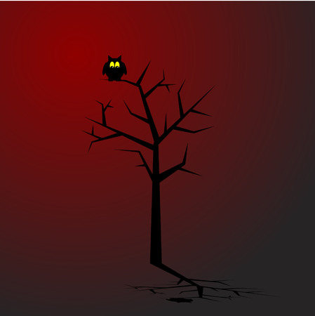 Owl sitting on a tree in spooky surroundings. Concept: Halloween.
