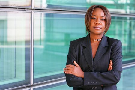 African american woman with arms folded confidently outside an office environment. Stock Photo - 2631322