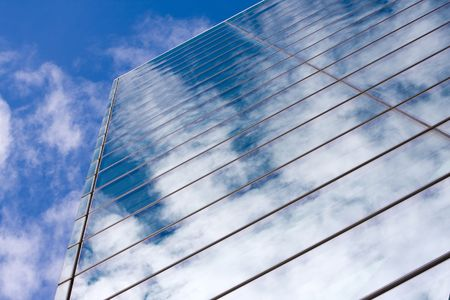 Modern glass office building reflecting the clouds. Stock Photo - 3319527