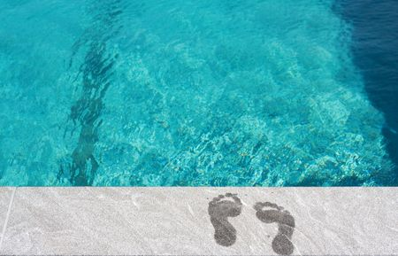 Foot steps by the swimming pool. Concept: Summer vacation by the beach photo