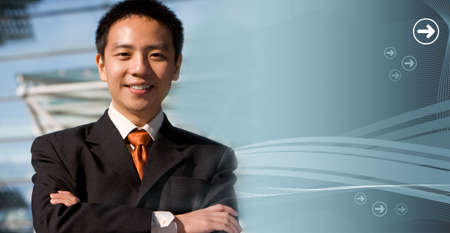 Handsome asian business man with a modern technology background photo