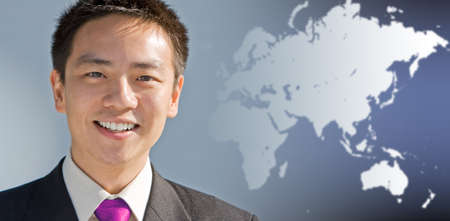 business asia: Handsome asian business man with a modern technology background
