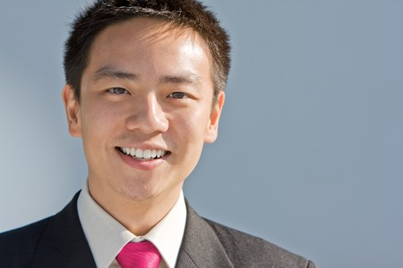 Good looking asian business man standing with formal suit. Stock Photo - 4141809
