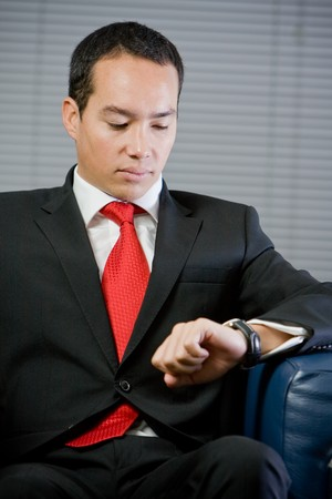 rushing hour: Handsome asian chinese business man looking at the time, his watch Stock Photo