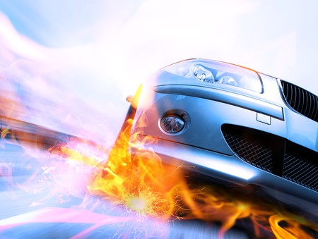 zooming: Fast car moving with motion blur with fire burning tires