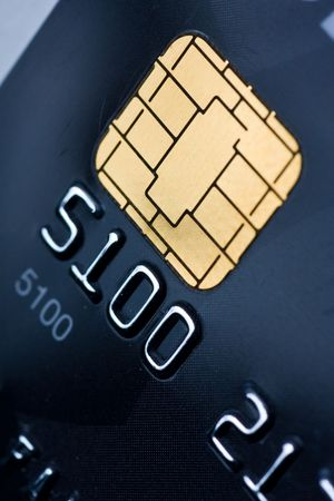 Closeup of a credit card with a gold chip