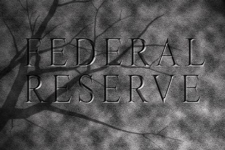 bleak: Federal reserve of america text in granite stone showing bleak future Stock Photo