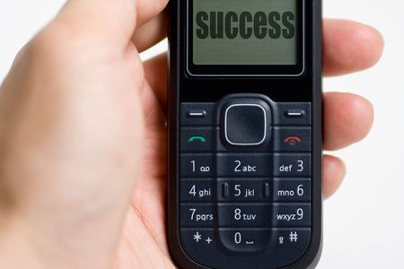Modern mobile or cell phone for global communication services with success message photo