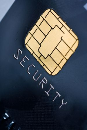 Closeup of a credit card with a gold chip photo