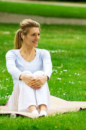 chilling out: Blonde girl in nature green park relaxing and chilling out