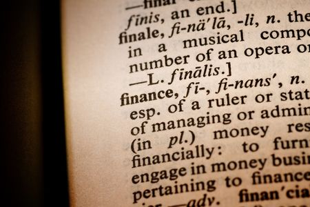Closeup of the word finance with a spot light on the text photo