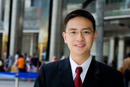 Handsome and good looking asian business man smiling photo