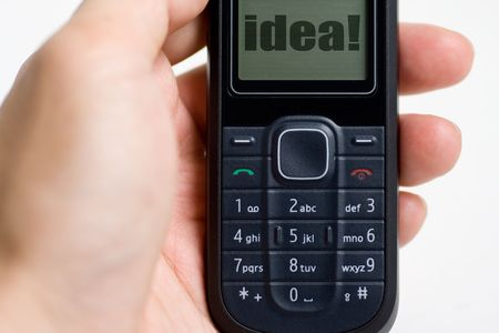 Modern mobile or cell phone for global communication services with idea photo