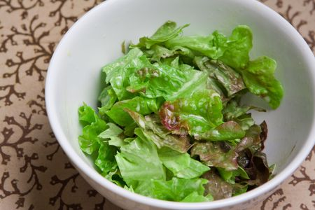 Fresh bowl of green salad with creamy white french dressing photo