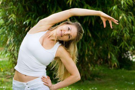 Blonde girl in nature green park exercising yoga, fitness program Stock Photo - 5446432
