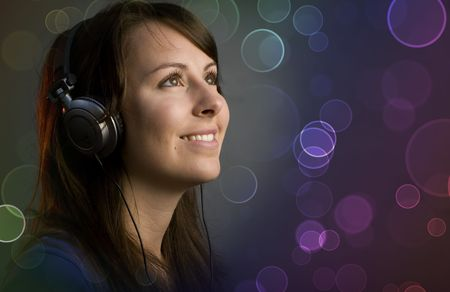 Young girl having fun at a disco or nightclub with retro headphones listening to music photo