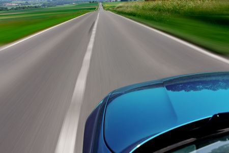 zooming: Blue car zooming fast down the highway road with motion blur Stock Photo