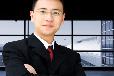 Handsome asian business man in suit at an airport Stock Photo