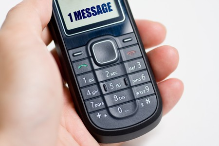 Modern mobile or cell phone for global communication services with 1 message photo
