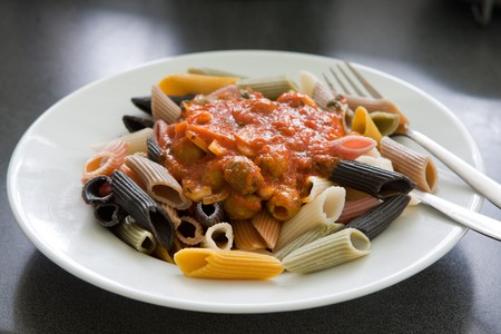 A plate of pasta on a white modern plate, popular italian dish photo