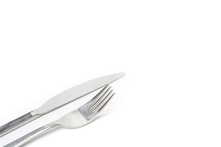 Fork and knife shot at a low diagonal angle with copy space Stock Photo - 8563226