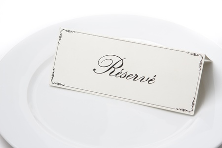 reserved sign: Generic reserved sign card on a white plate