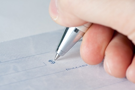 Close up shot of a cheque or cheque with a pen Stock Photo - 9763535