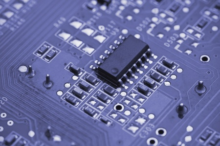 Macro shot of a printed circuit board with details of connection and chip Stock Photo - 9857612
