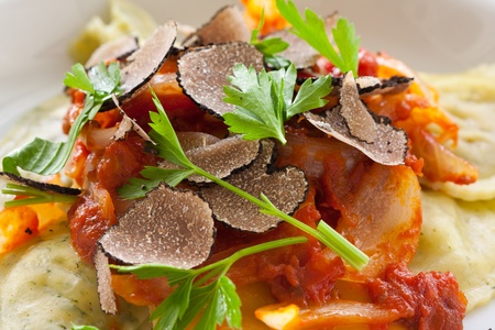 Freshly made italian ravioli pasta with slices of black truffle Stock Photo