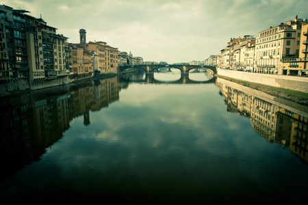processed: Cross processed view of ponte vecchio with reflection on the arno river