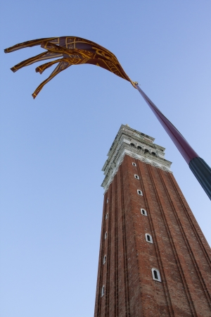 saint marco: Venice Italy campanile tower with flying flag Stock Photo