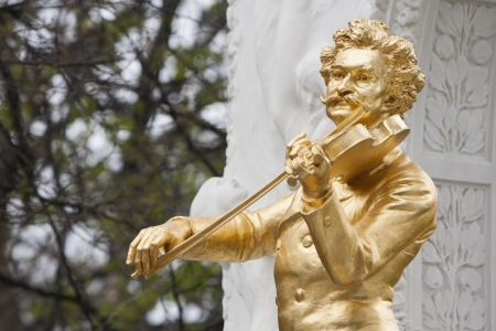 Golden Johann Strauss playing the violin statue in Vienna Austria photo