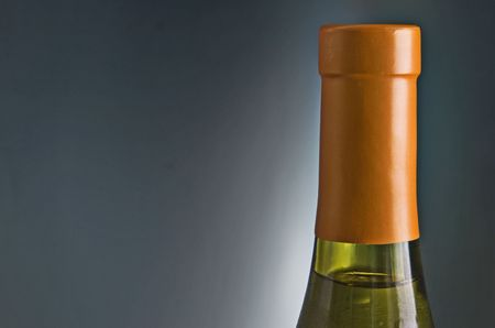 Wine bottle against gray background with copy space Imagens