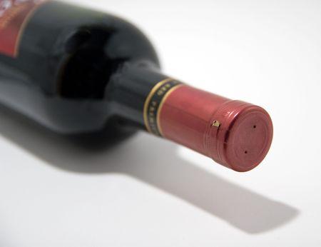 Wine bottle on its side against white background Imagens