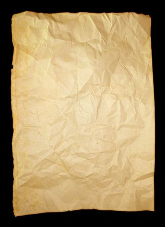 Single sheet of old crumbled paper on black background
