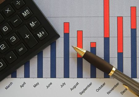 financial item: Chart calculator and pen Stock Photo