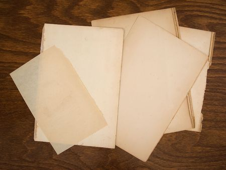 Selecion of old paper on wood background Imagens