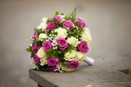 The beautiful wedding bouquet of the bride from roses with the design decision the lonely lies on the nature Stock Photo