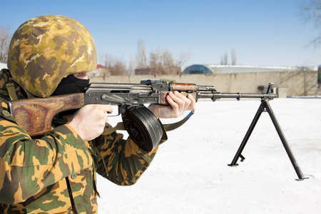 The military man with the weapon Stock Photo