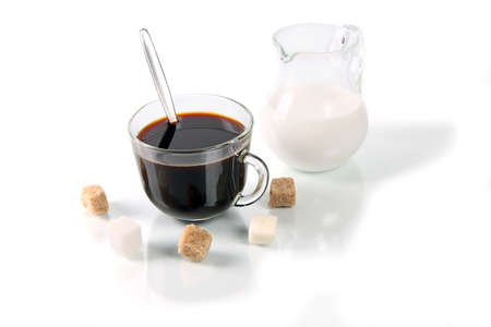 Coffee with milk and sugar parts on white  background with reflexion Stock Photo