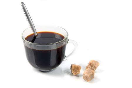 Coffee and sugar parts on white background with reflexion Stock Photo