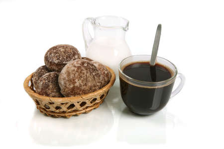 Coffee with milk and spice-cakes on white background with reflexion