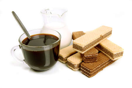 Coffee with milk and wafers on a white background with reflexion