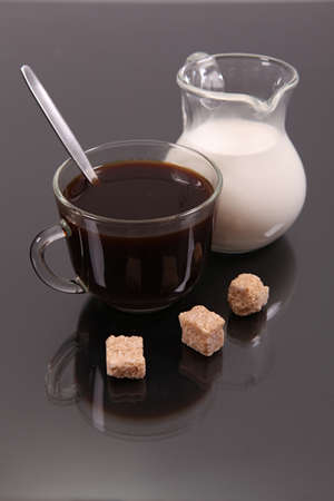 Coffee with milk against a dark background with reflexion Stock Photo